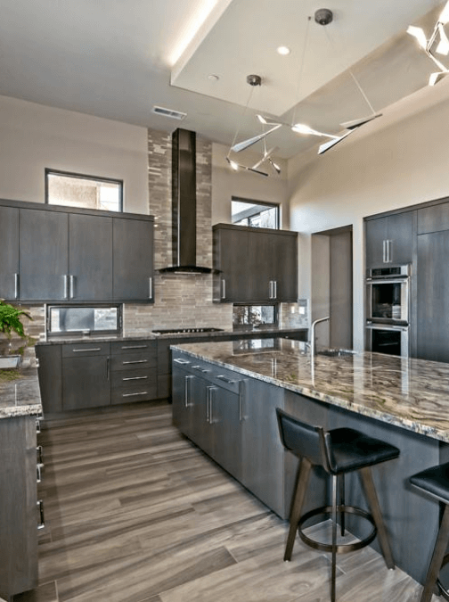 Kitchen with Granite Countertops and Wooden Floor CTC Tile